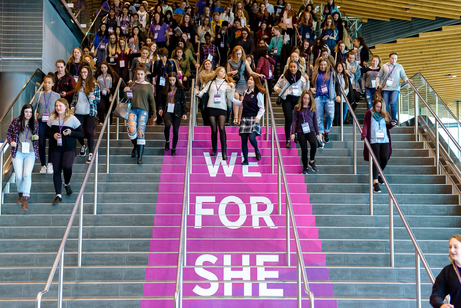Picture Of Young Women Arriving At WE FOR SHE